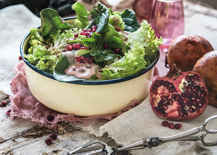 Green salad with yogurt vinaigrette and pomegranate